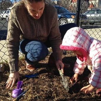Maestra planting with Spanglish Kids